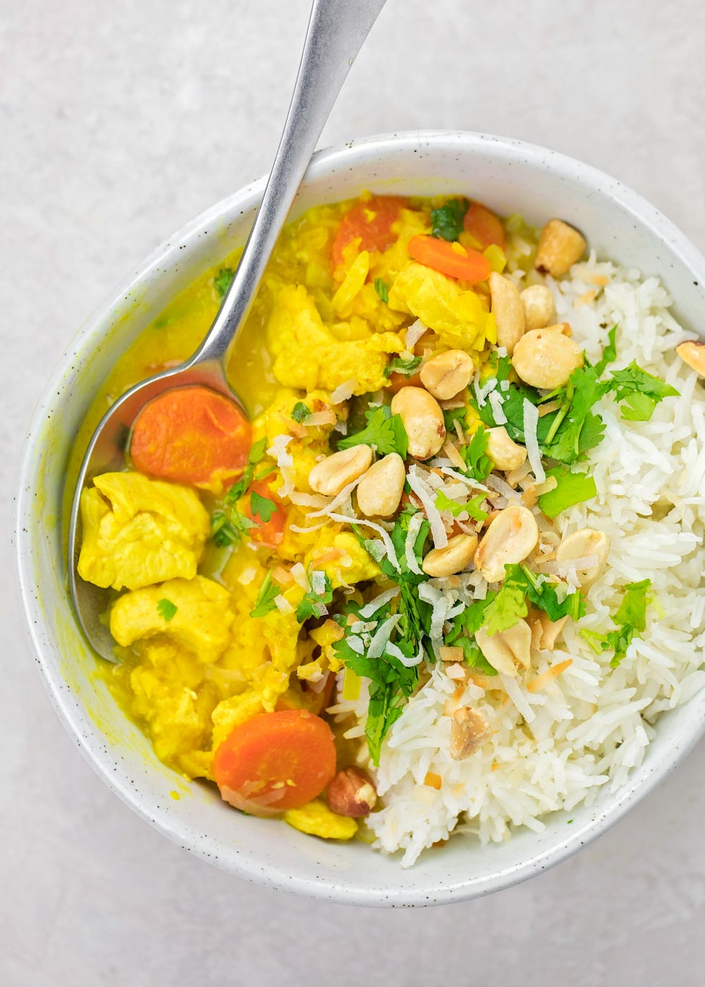 Coconut lentil curry in a bowl with white rice