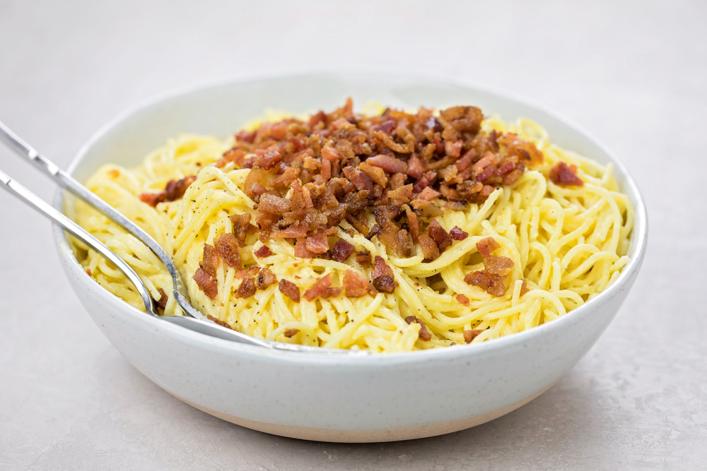 Pasta carbonara in a white bowl