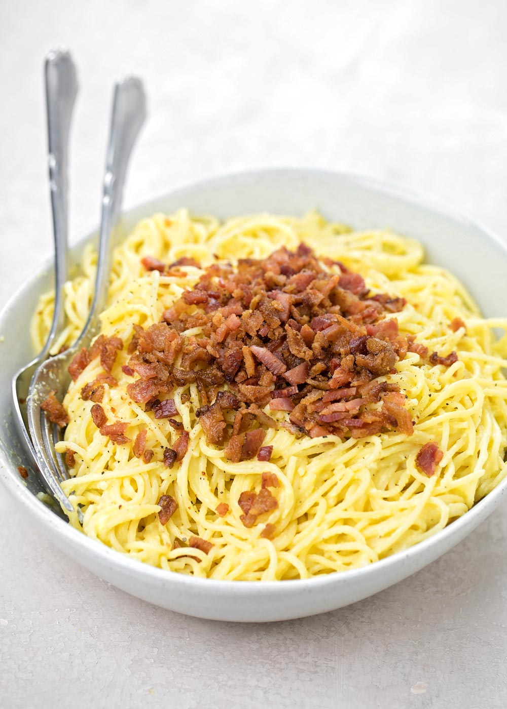 Close up of pasta carbonara in a white bowl