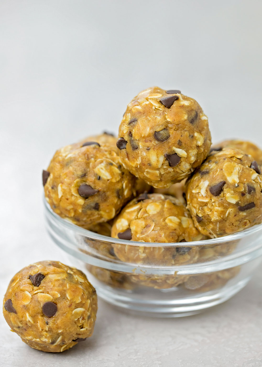 Peanut butter energy balls stacked in a bowl