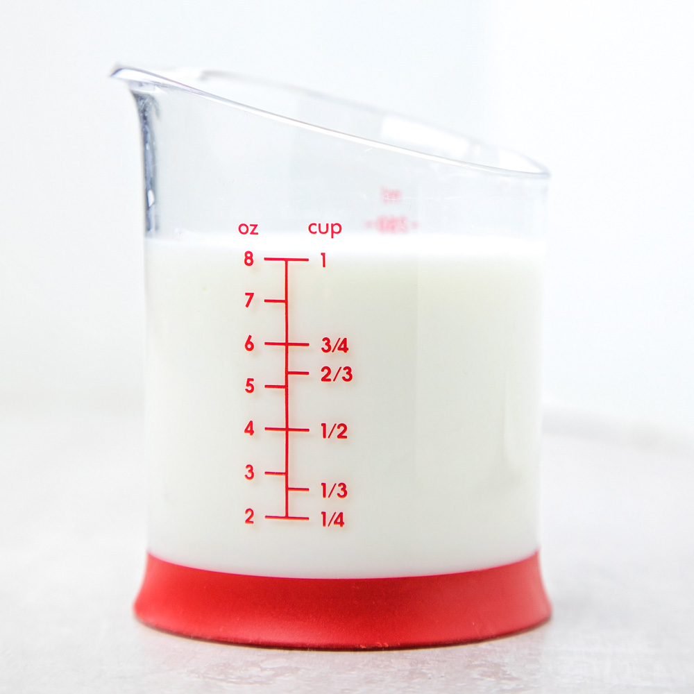 Homemade buttermilk in a measuring cup