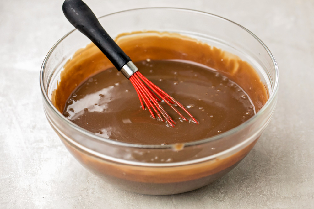 Homemade chocolate pudding in a class mixing bowl