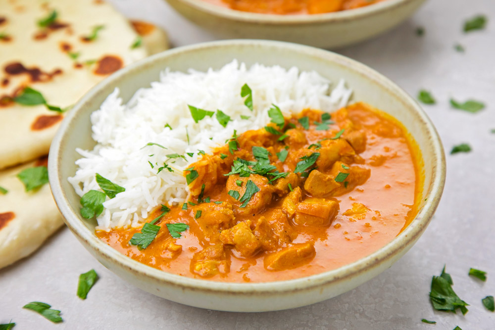 Instant Pot Butter Chicken in a bowl with basmati rice