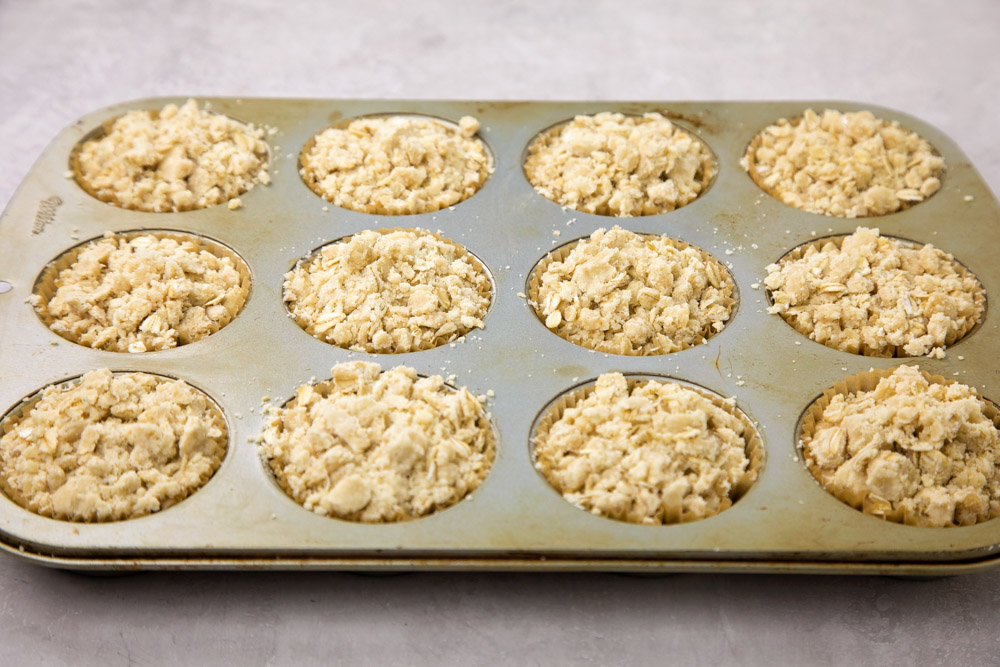 Easy oatmeal muffins with crumb topping in a baking tin
