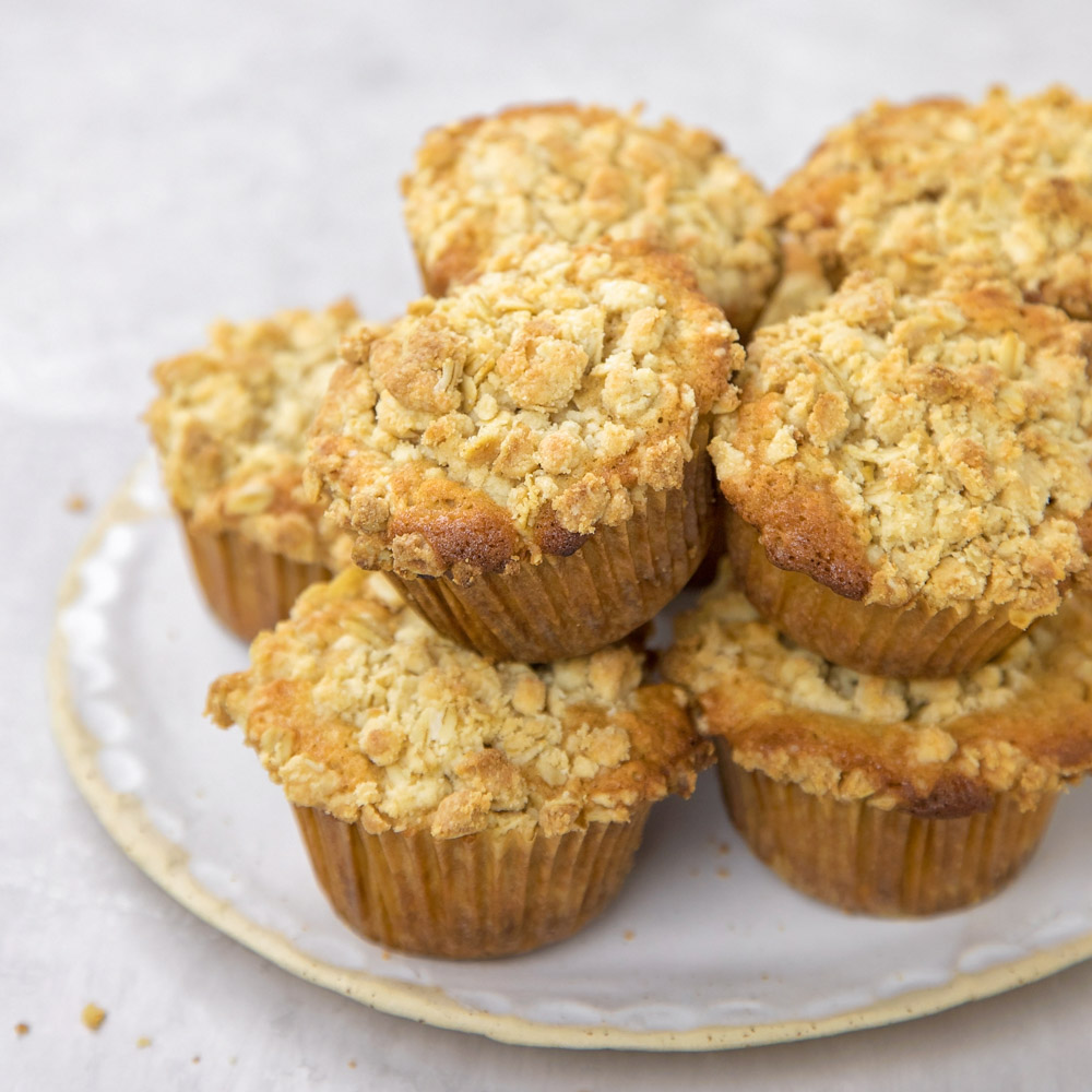 Stack of oatmeal muffins on a white plate