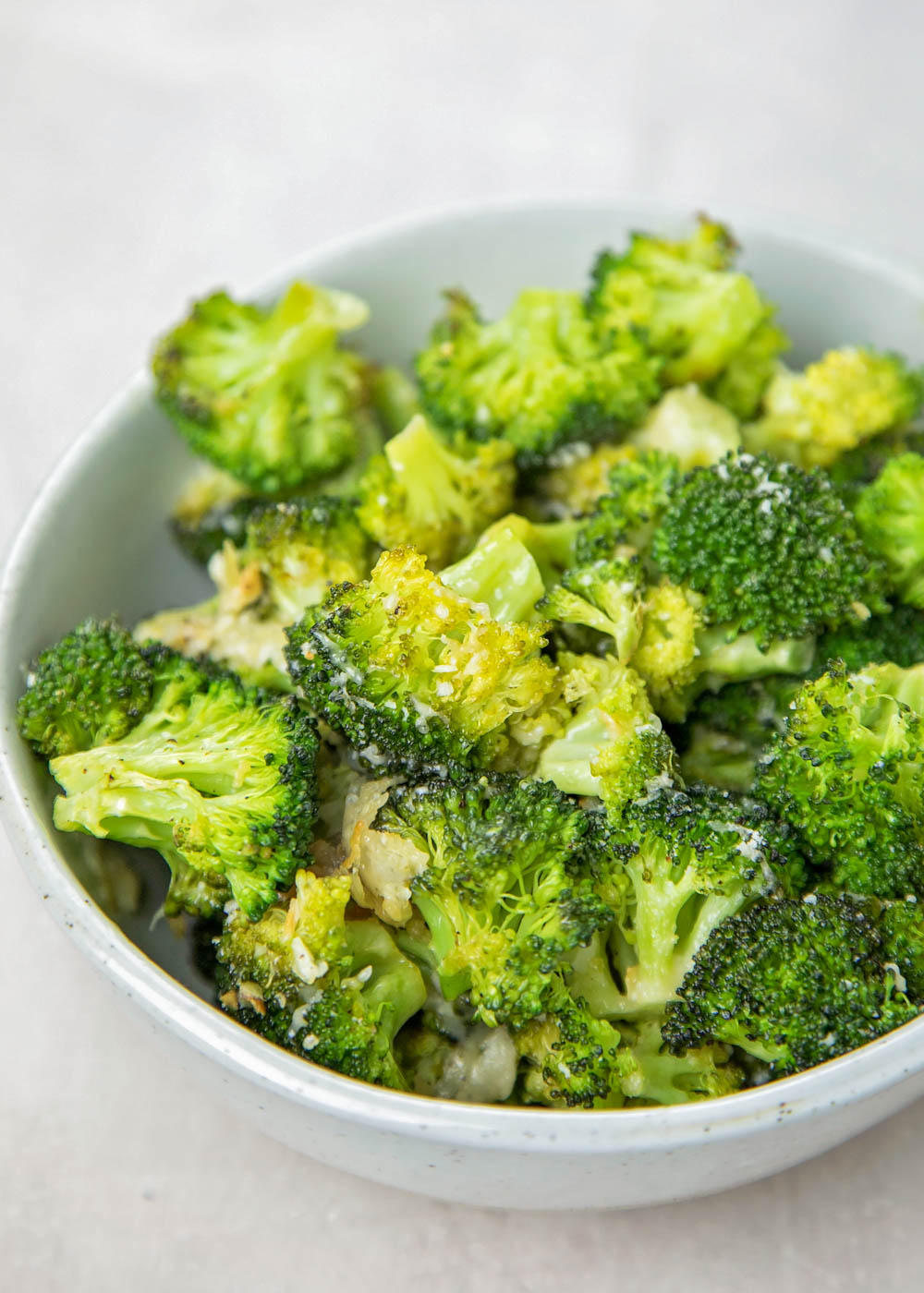 Close up of oven roasted broccoli in a bowl