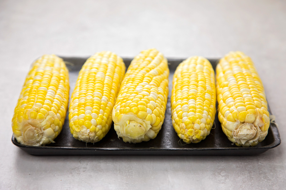 5 pieces of corn on the cob ready to be cooked