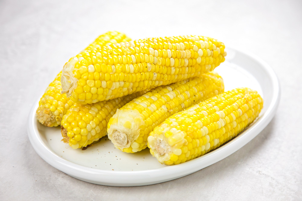 Instant pot corn on the cob on a white plate