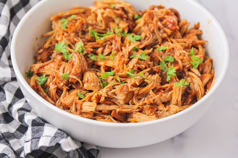 Instant Pot BBQ Pulled Pork in a white bowl