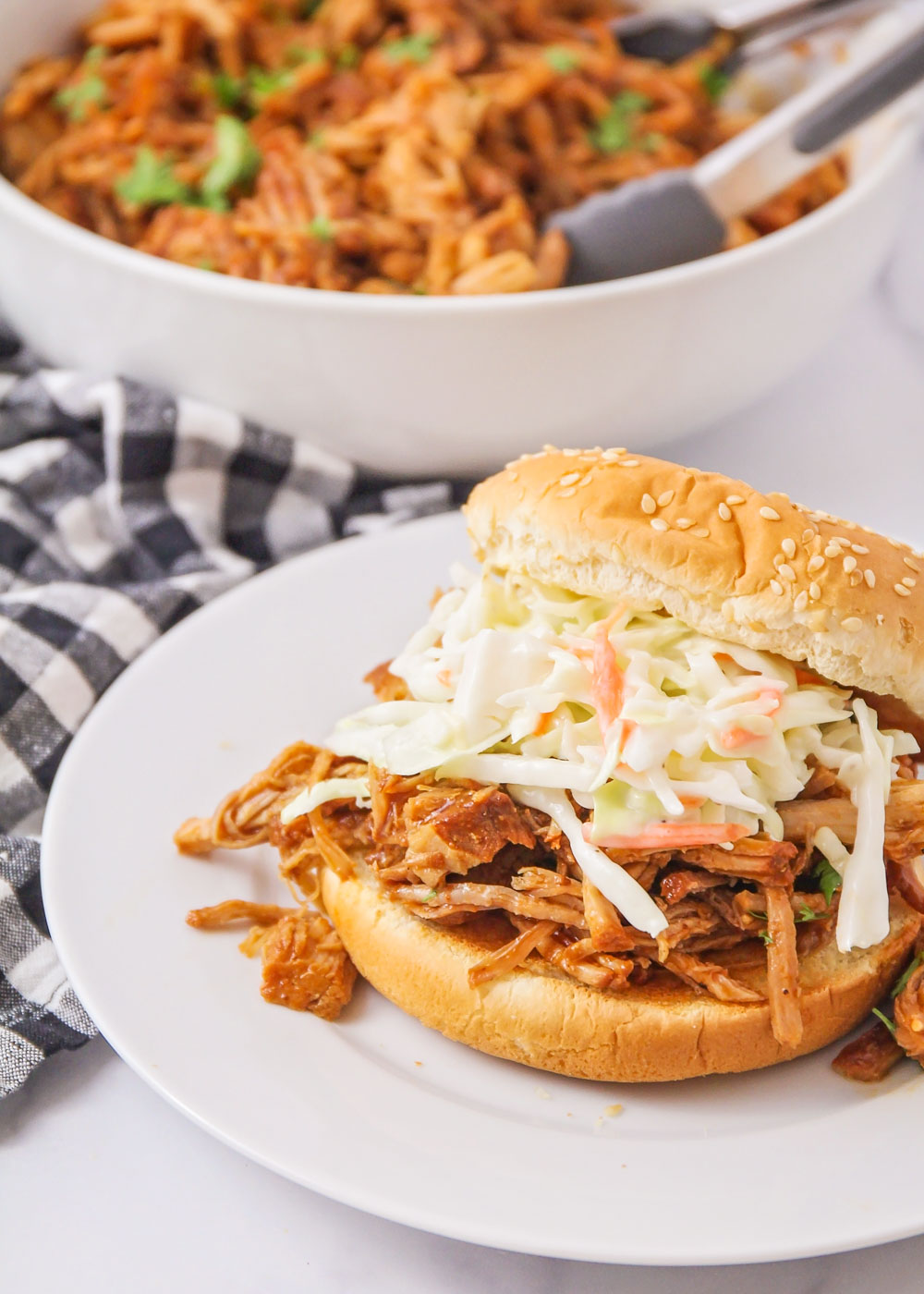Instant Pot Pulled Pork on a bun topped with coleslaw