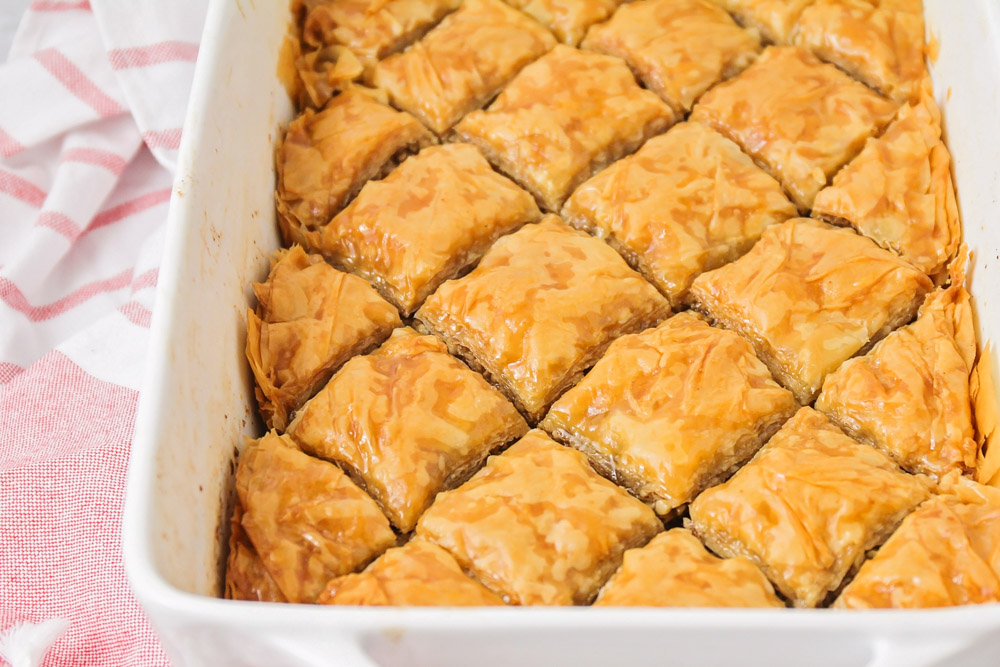Baklava cut into pieces in a serving dish