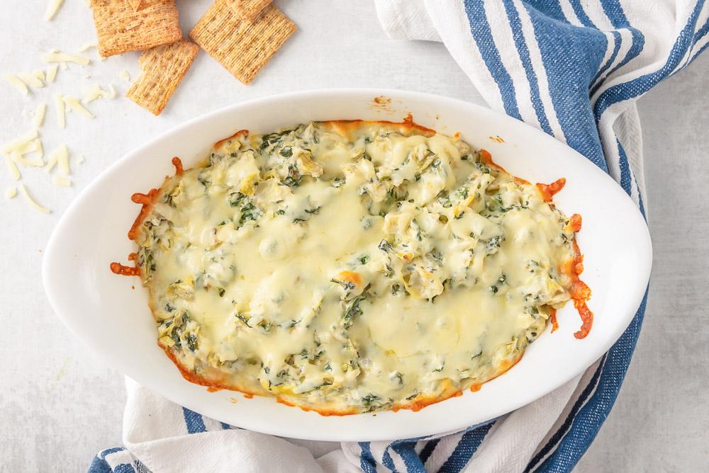Artichoke Dip in a white serving dish