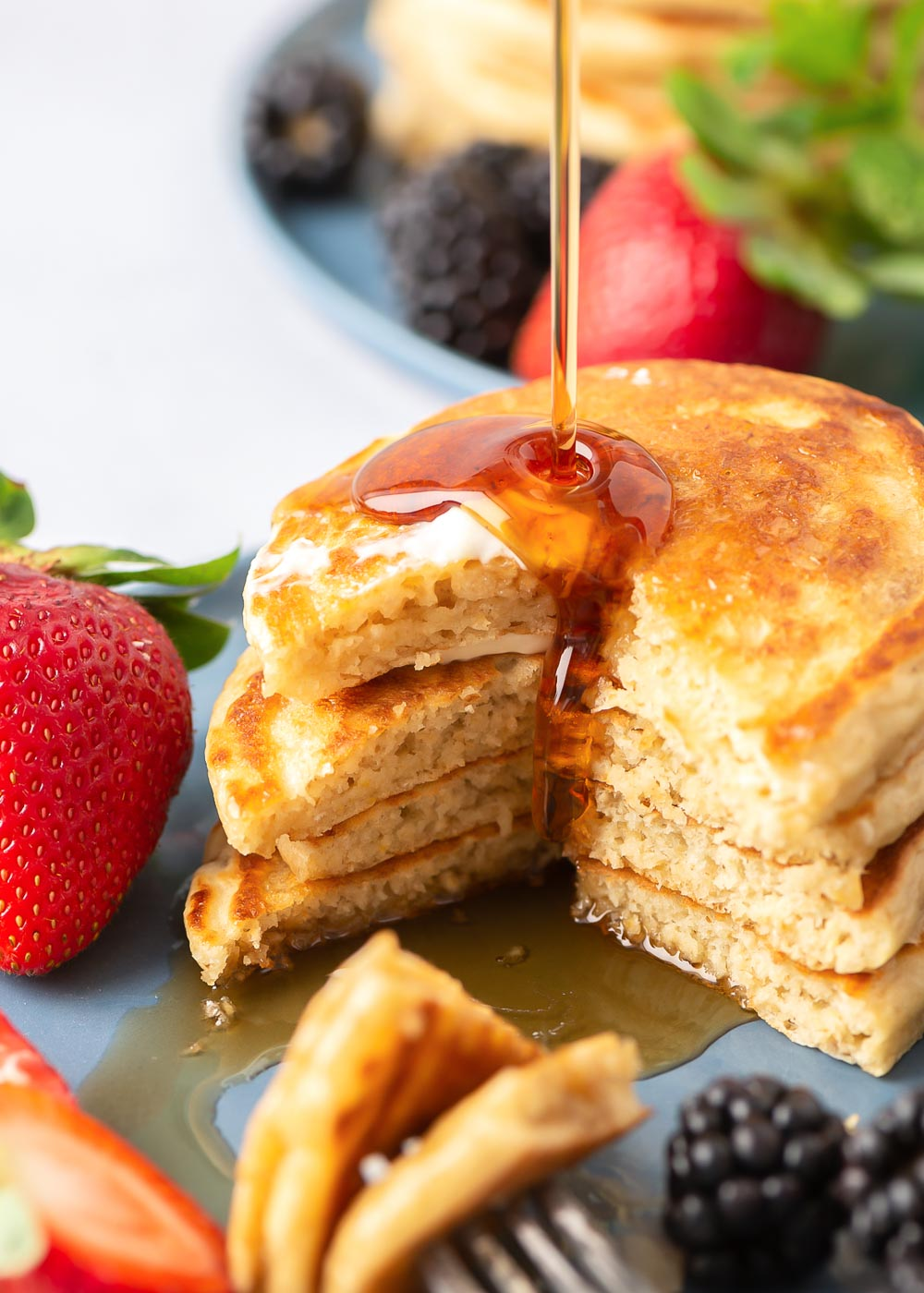 A stack of healthy oatmeal pancakes with syrup