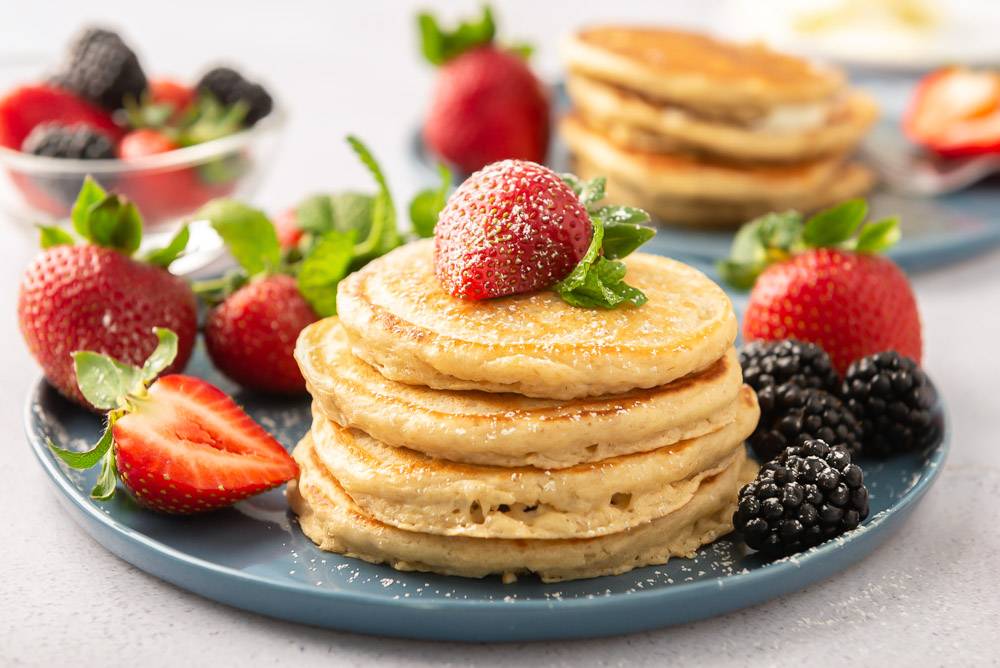 A stack of oatmeal pancakes on a blue plate