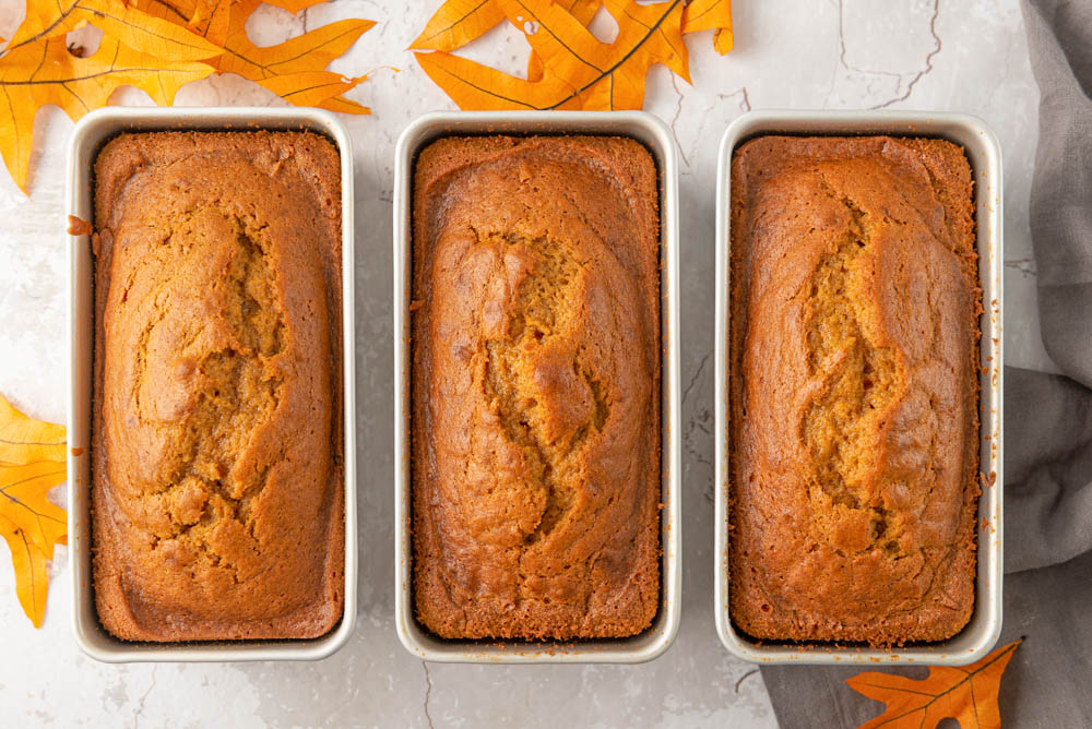 Three loaves of pumpkin bread in loaf pans