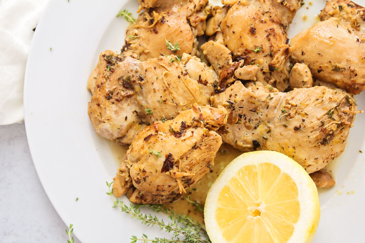 Instant pot chicken thighs on a white plate