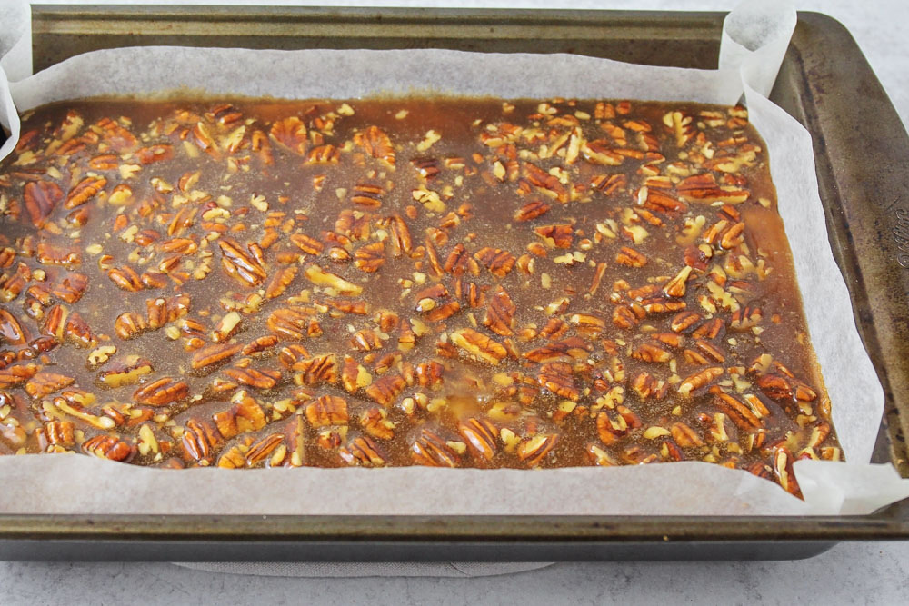 Pecan pie bar recipe in a metal baking pan