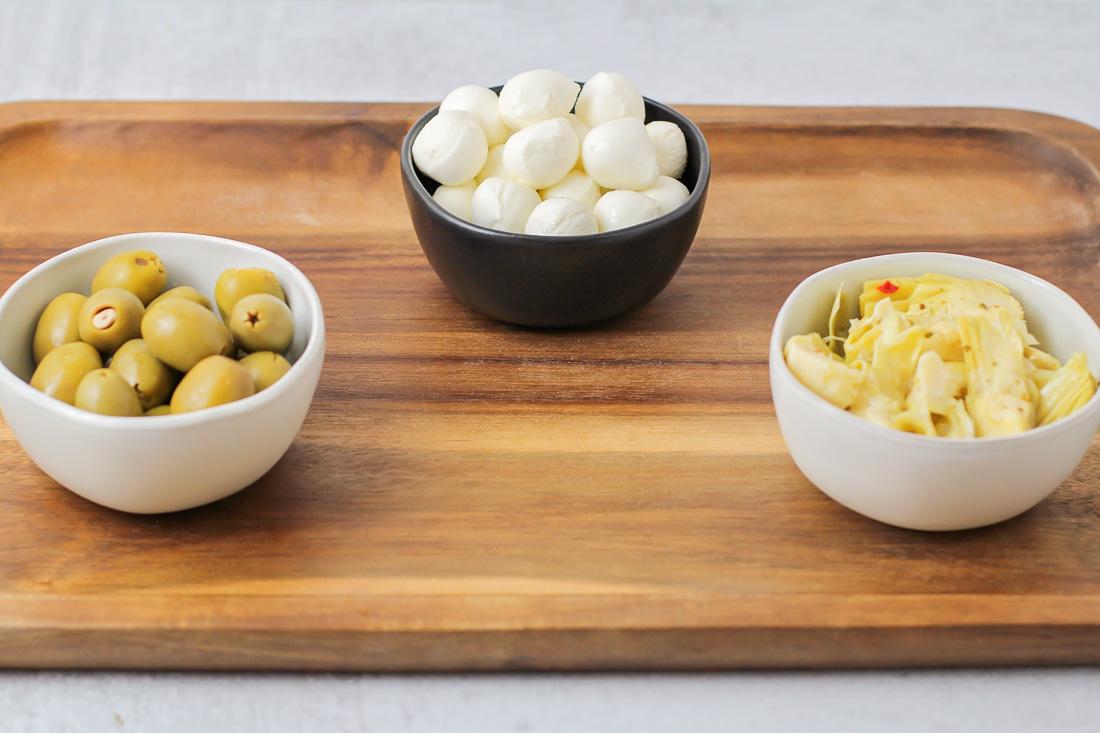 Putting bowl items on antipasto platter