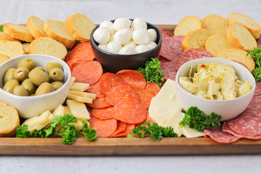 Antipasto Platter Recipe with meats, chesses, and bread slices