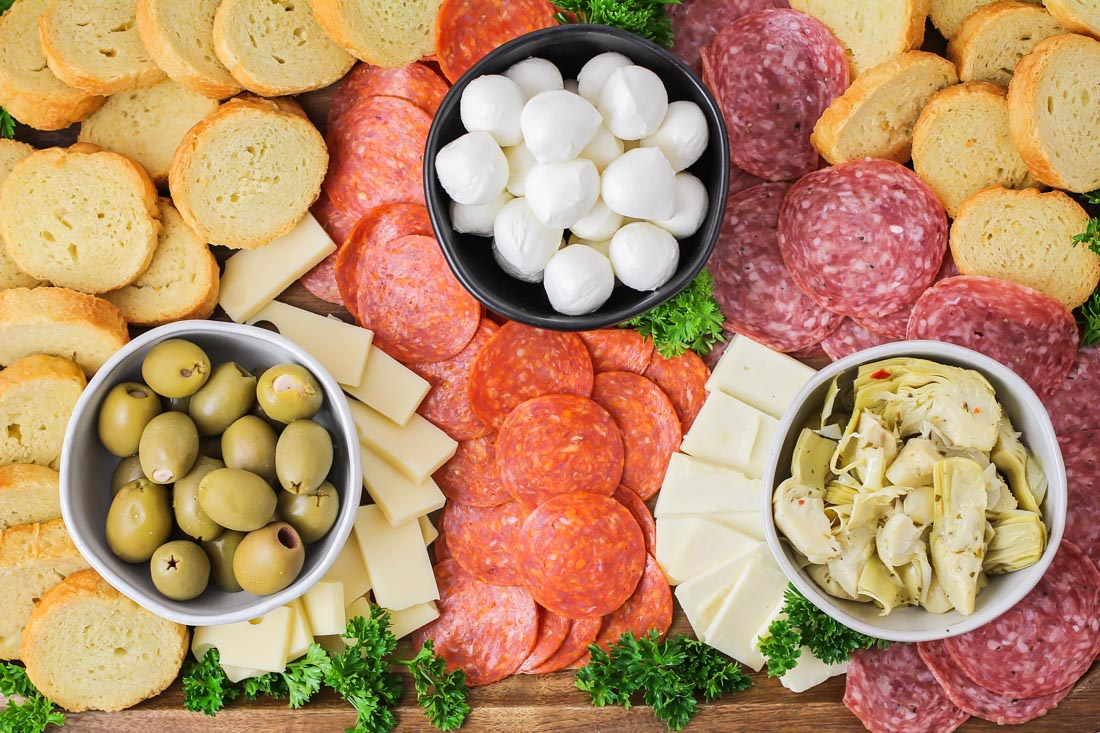 Antipasto platter with meats, cheeses, olives, and artichokes