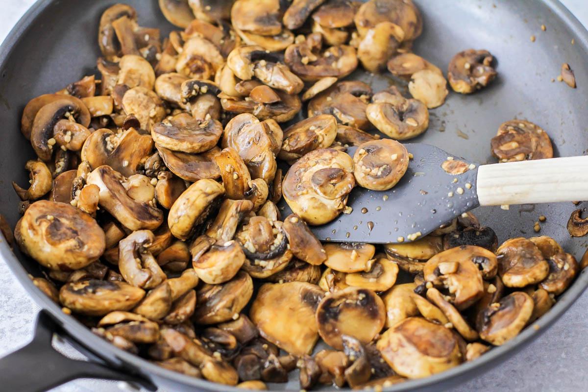 Sautéing mushrooms in a skillet