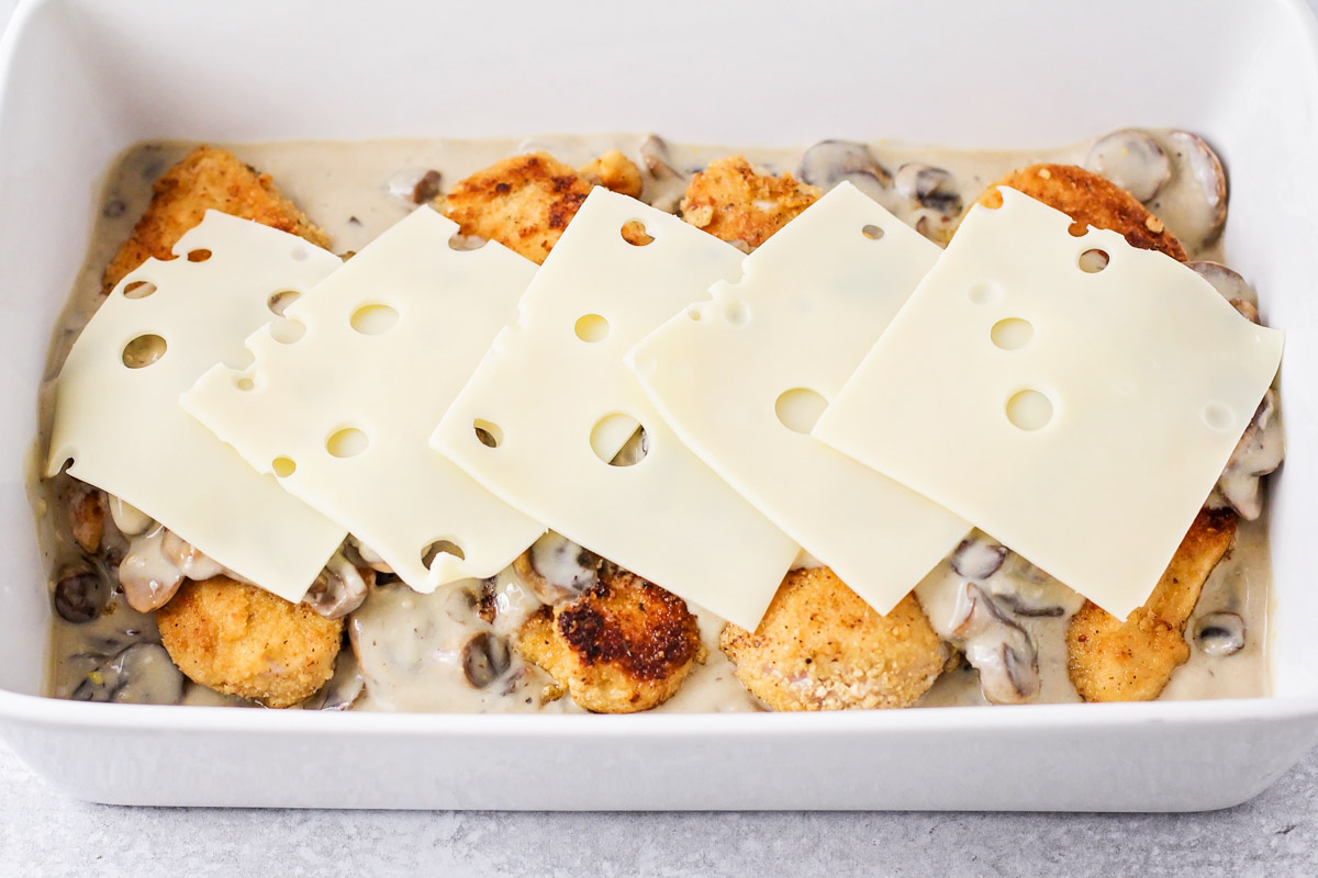 Chicken and mushroom sauce with slices of cheese on top
