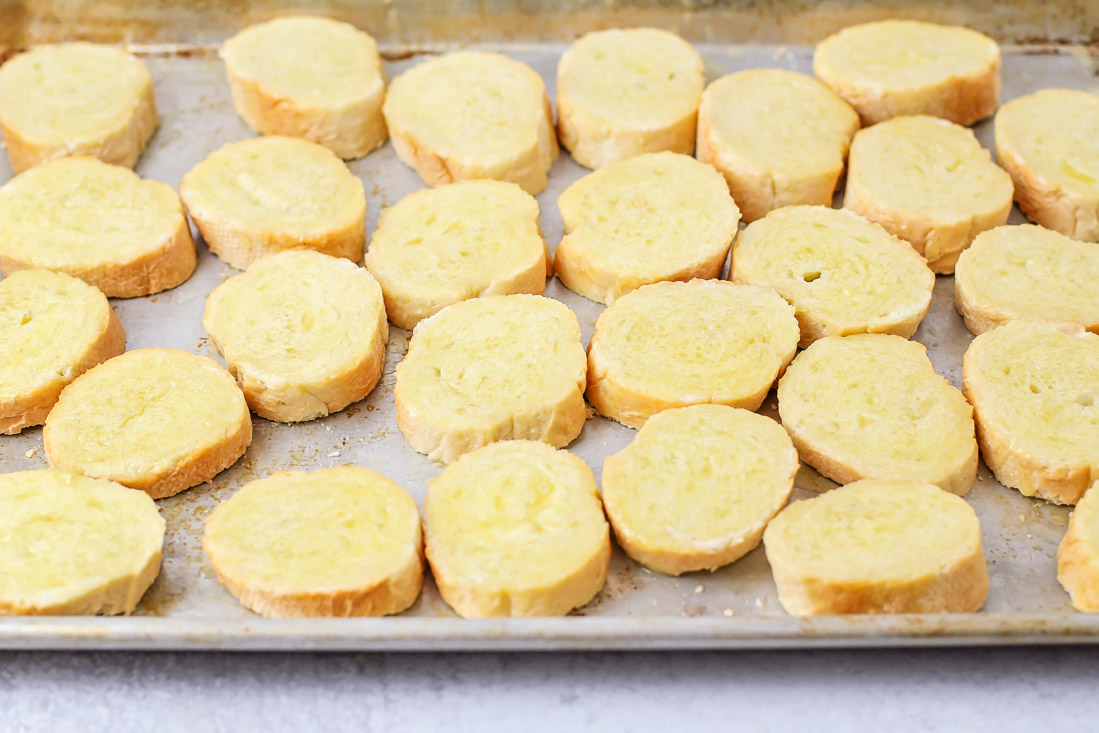 How to make crostini by toasting on a sheet pan in the oven
