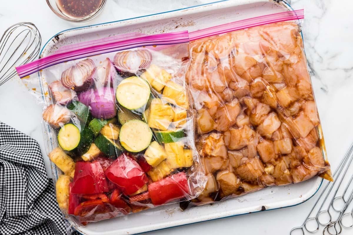 Chicken and vegetables sitting in chicken kabob marinade