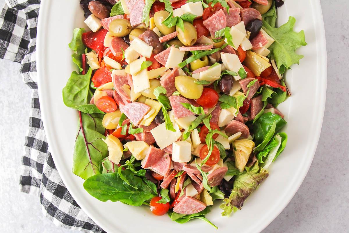 Antipasto salad on a white serving platter