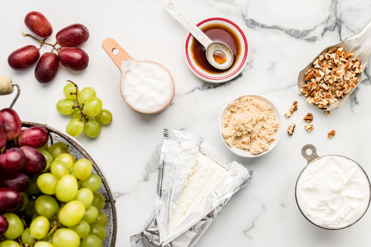 Grape salad ingredients on a marble countertop
