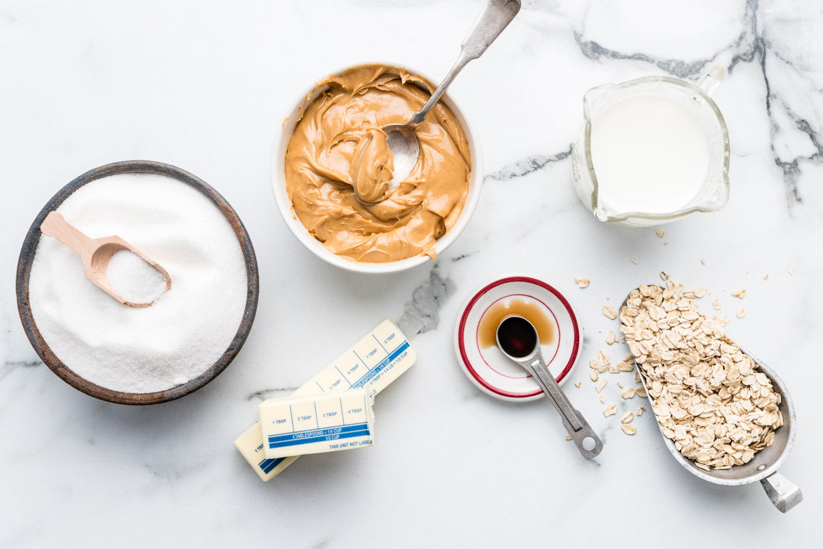 Ingredients for peanut butter no bake cookie recipe on a marble countertop