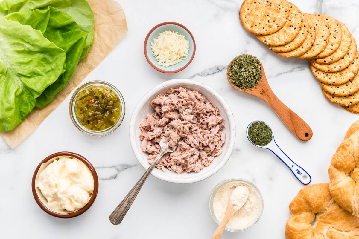 Tuna salad ingredients on a marble countertop