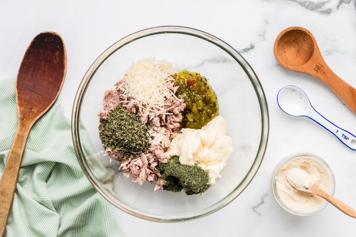 Mixing tuna salad recipe in a mixing bowl