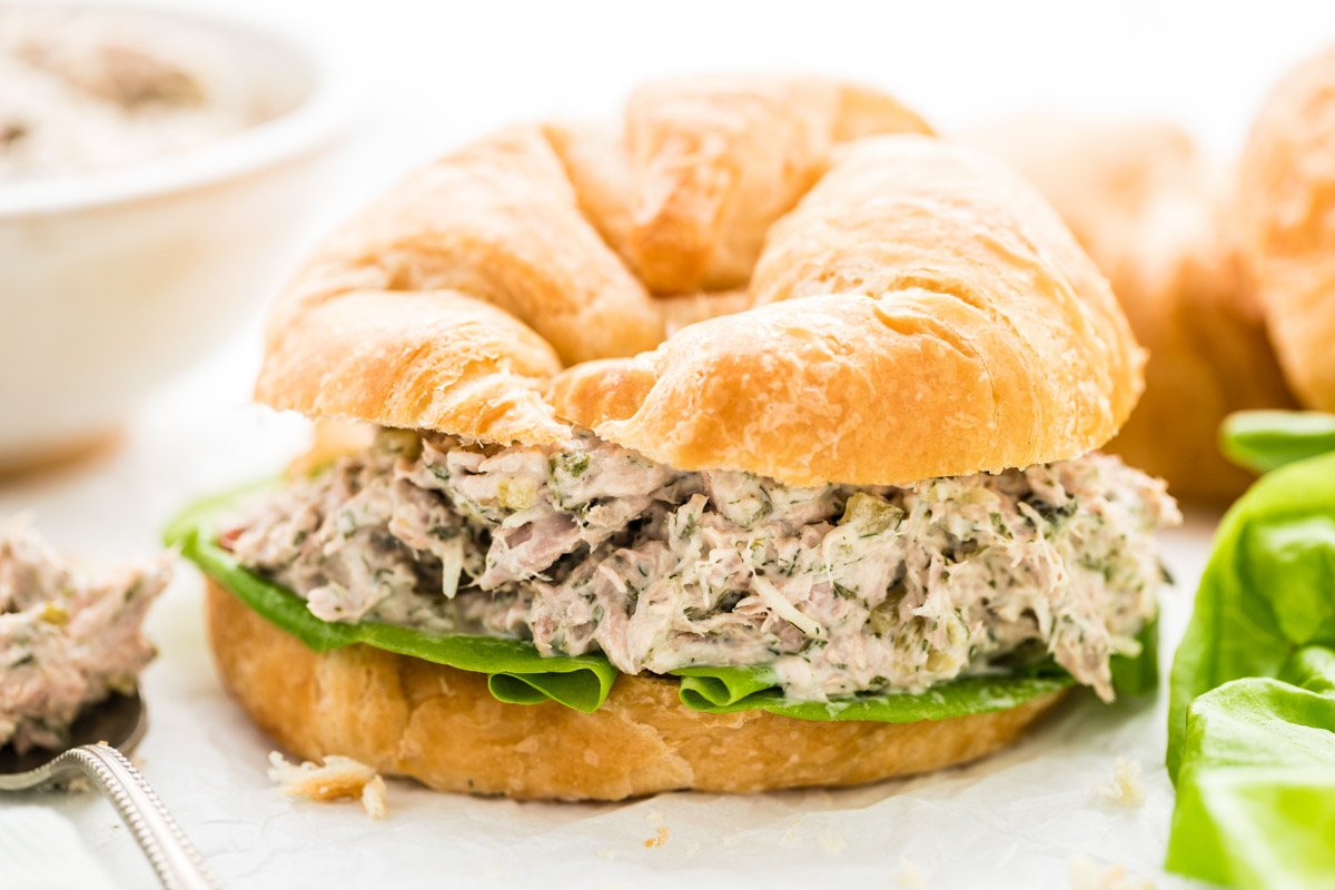 Tuna salad sandwich made with a croissant