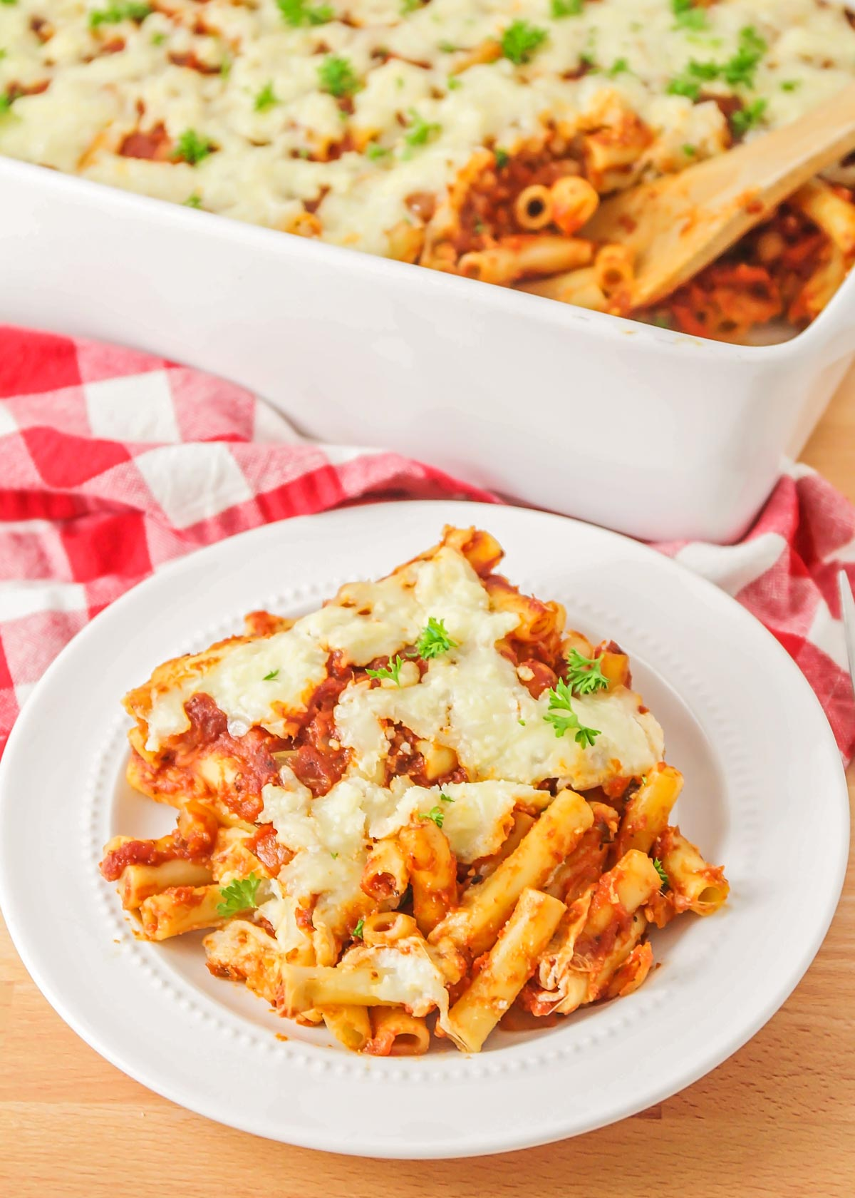 A scoop of meatless baked ziti on a white plate
