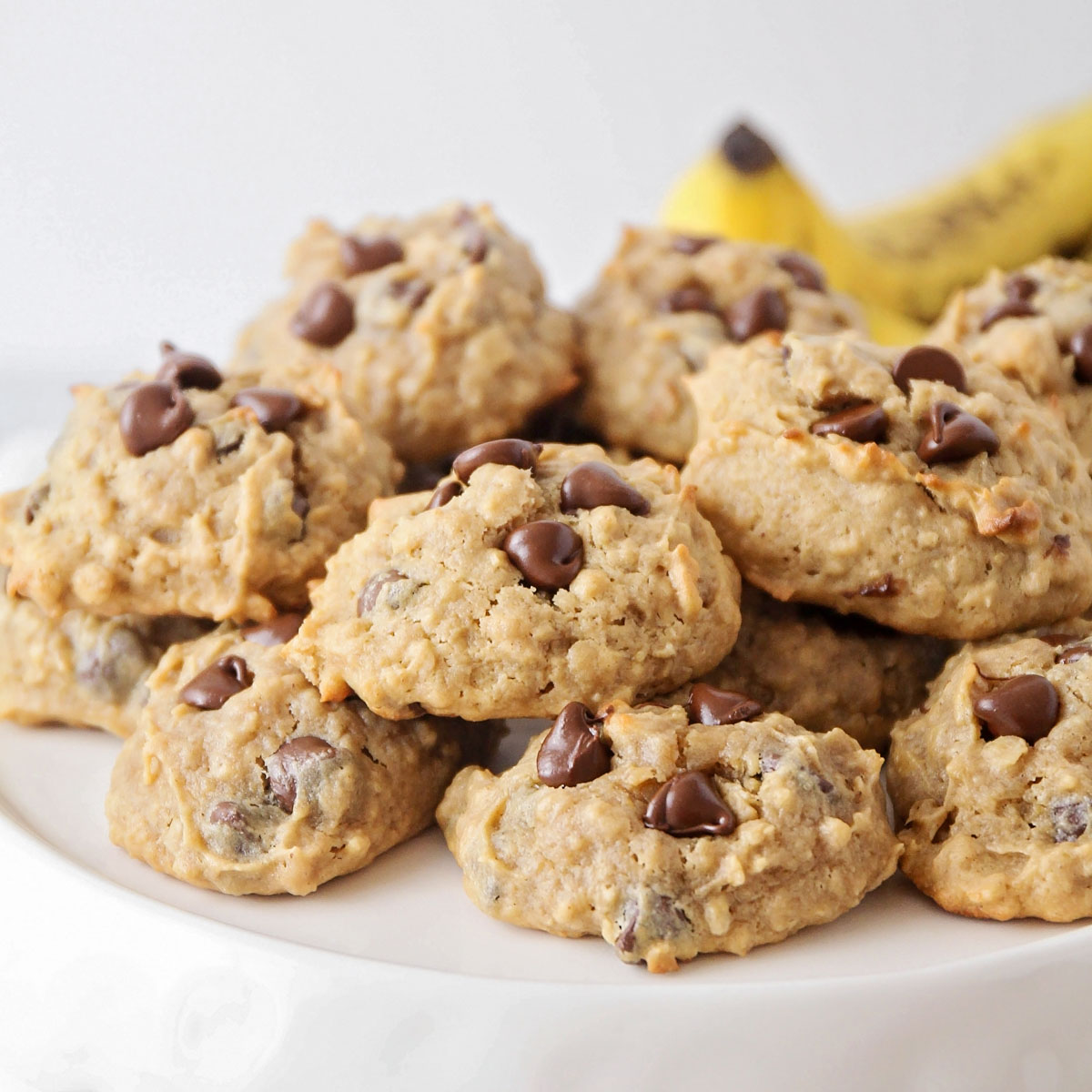 Peanut Butter Banana Cookies stacked on a white platter