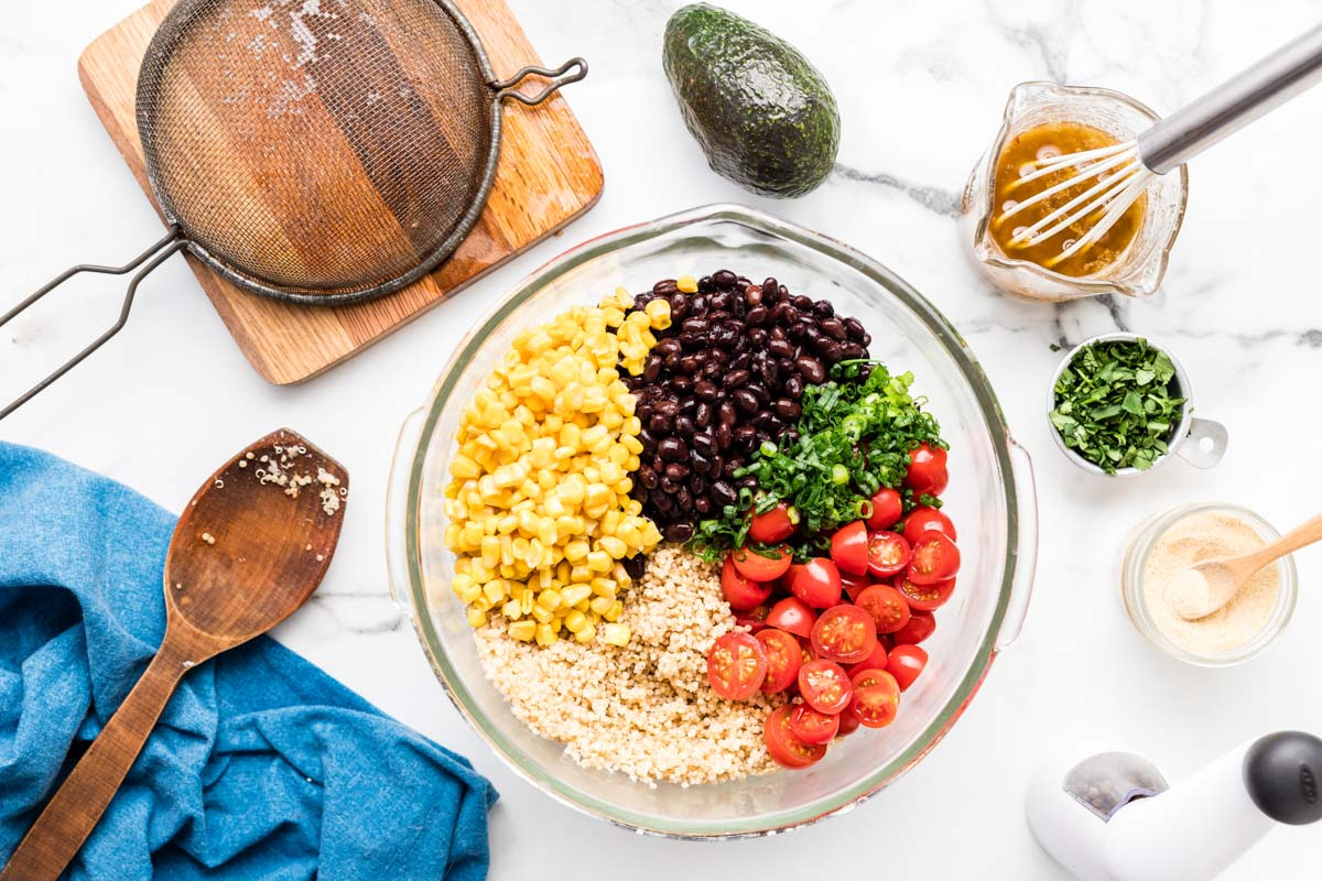 How to make quinoa salad - combining ingredients in a glass bowl