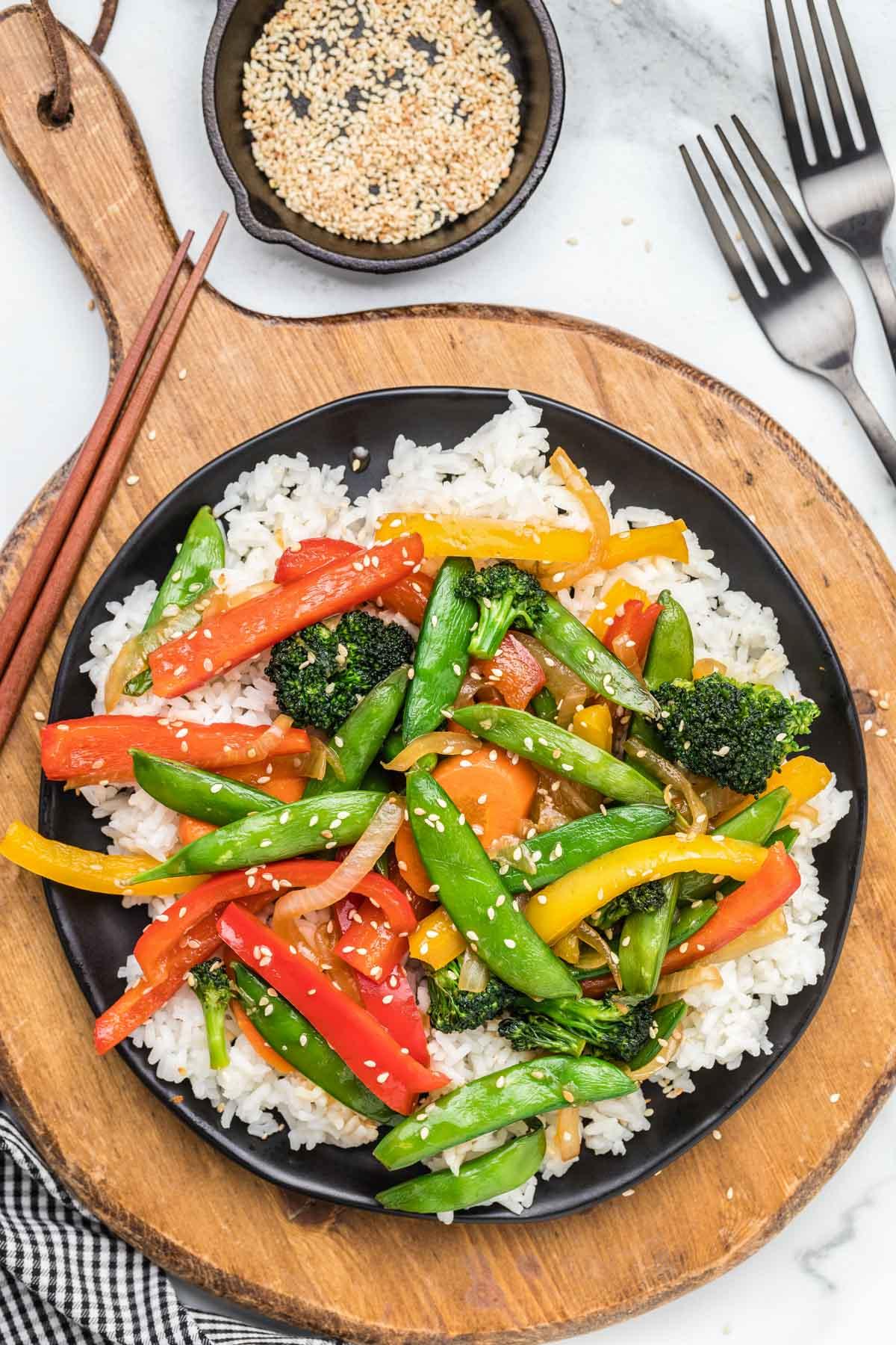 Homemade vegetable stir fry served over white rice