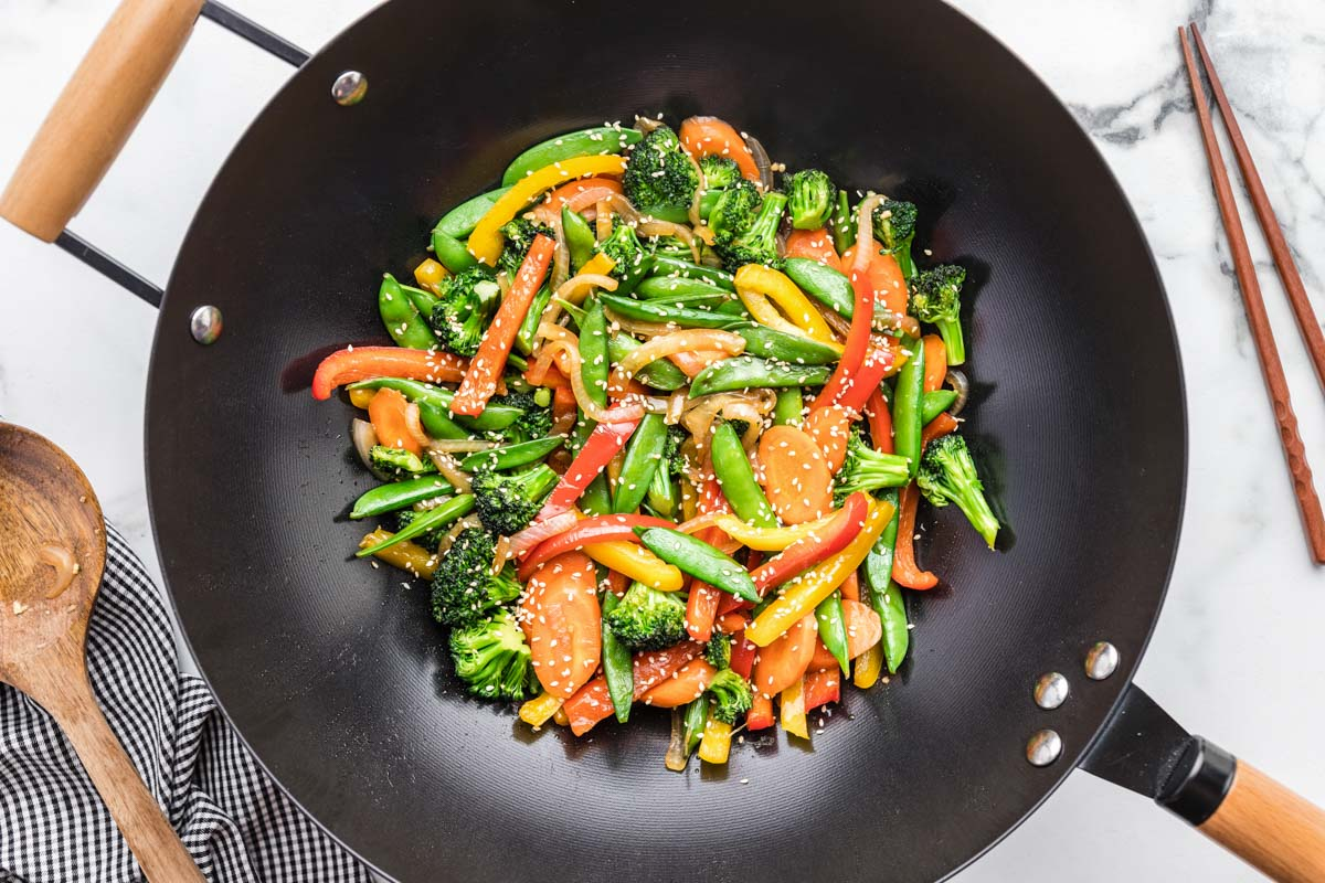 Healthy vegetable stir fry cooking in a wok
