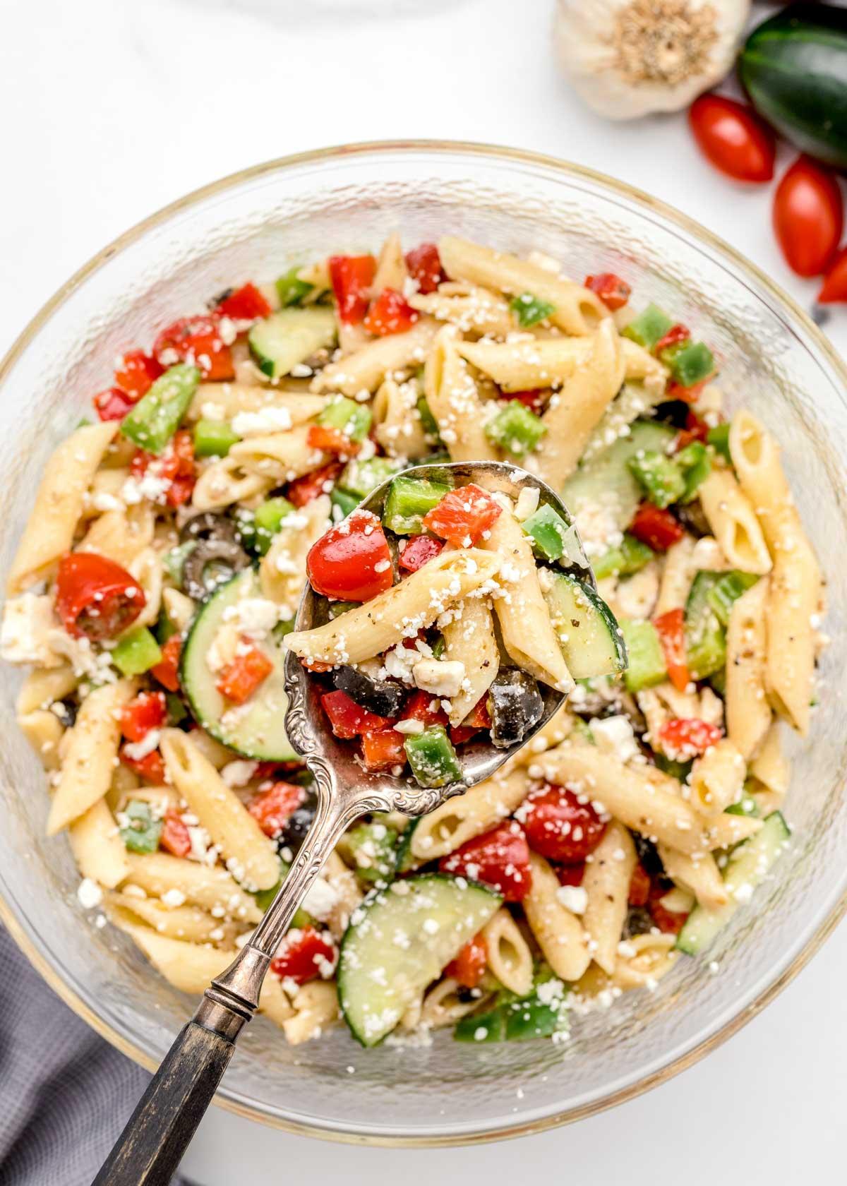 Pasta salad covered in Greek Pasta Salad Dressing