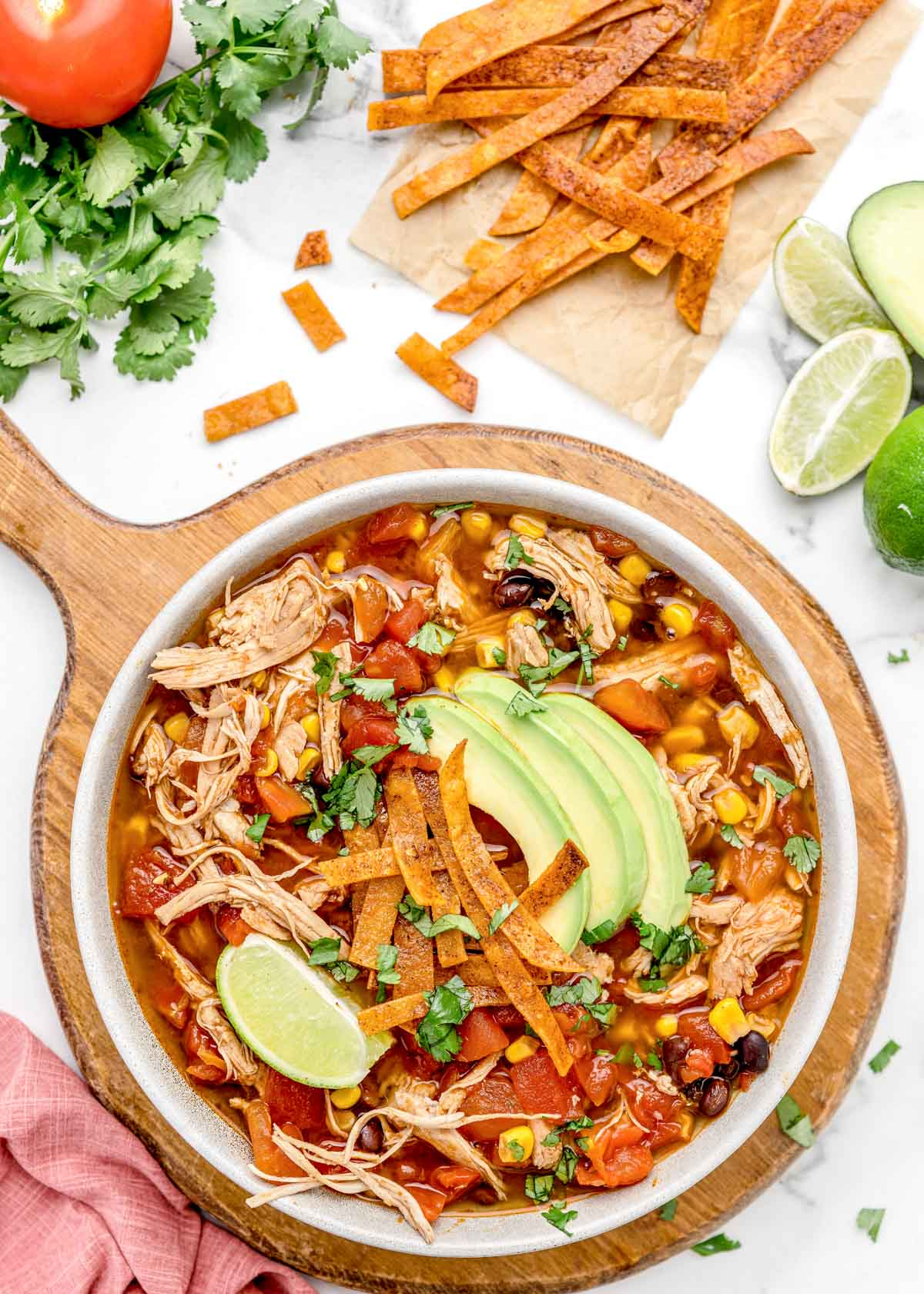 Instant pot chicken tortilla soup with toppings in a white bowl