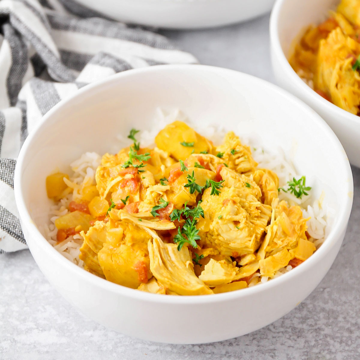 Instant Pot Coconut Curry Chicken served in a bowl over white rice