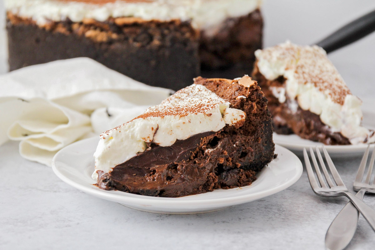 A slice of mississippi mud pie on a white plate