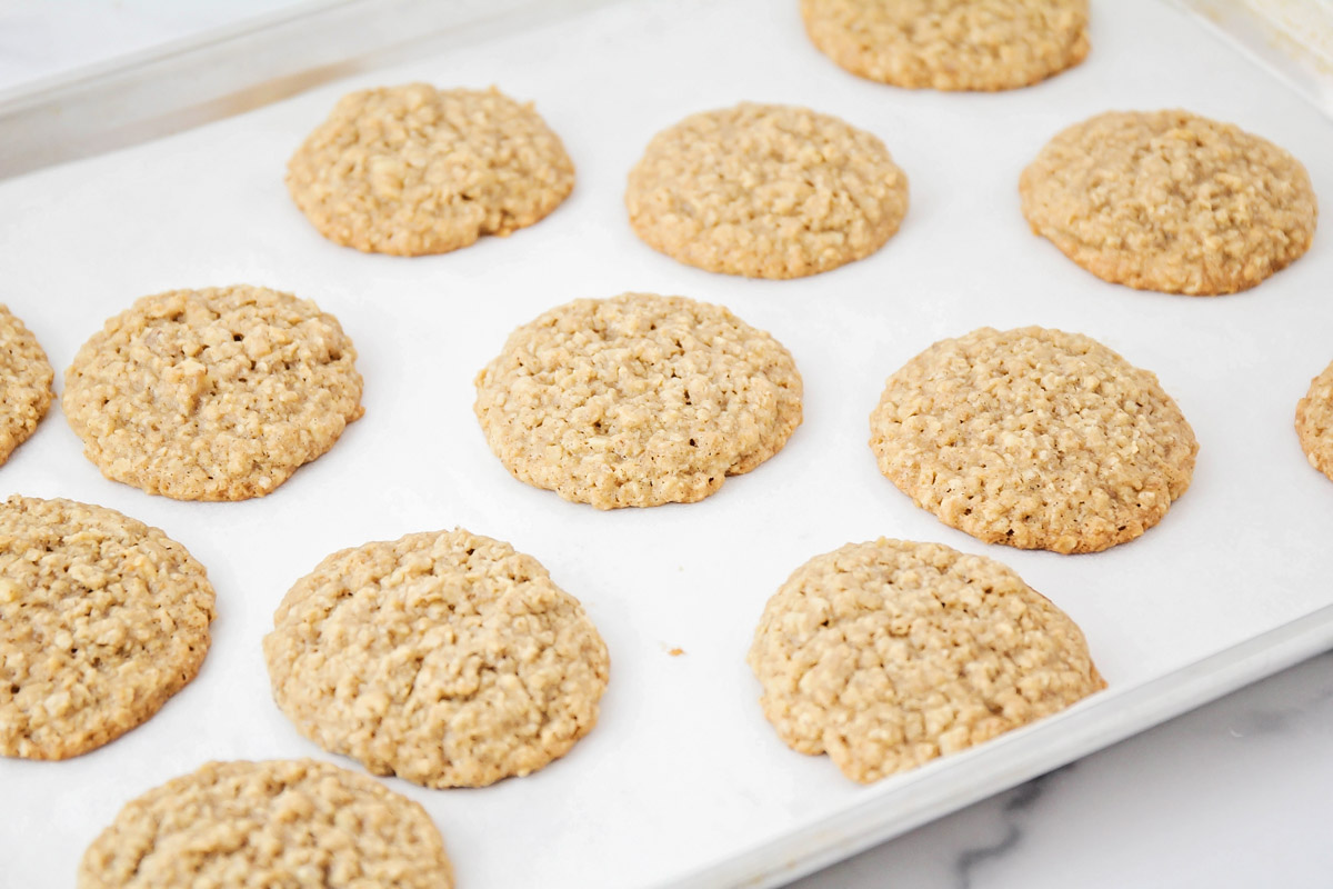 Chewy oatmeal cookies on a baking sheet