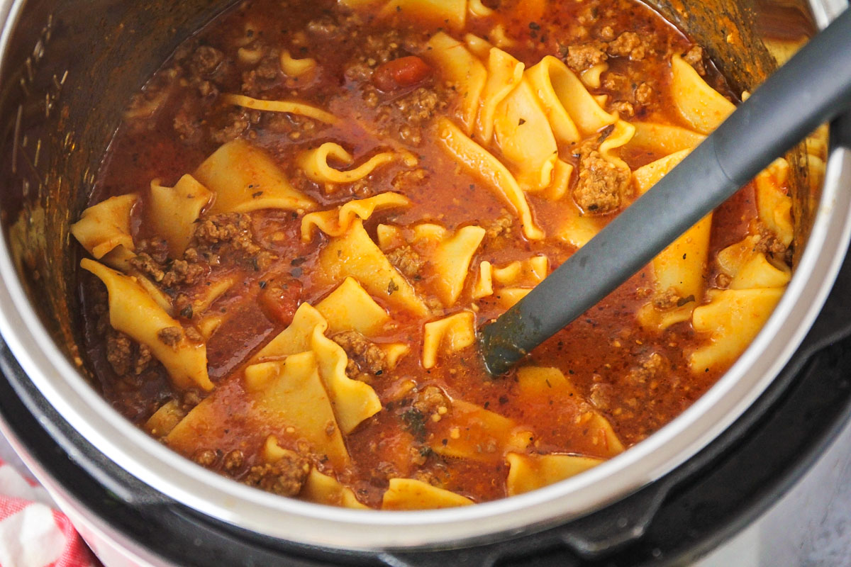 Instant Pot Lasagna Soup being stirred with a spoon