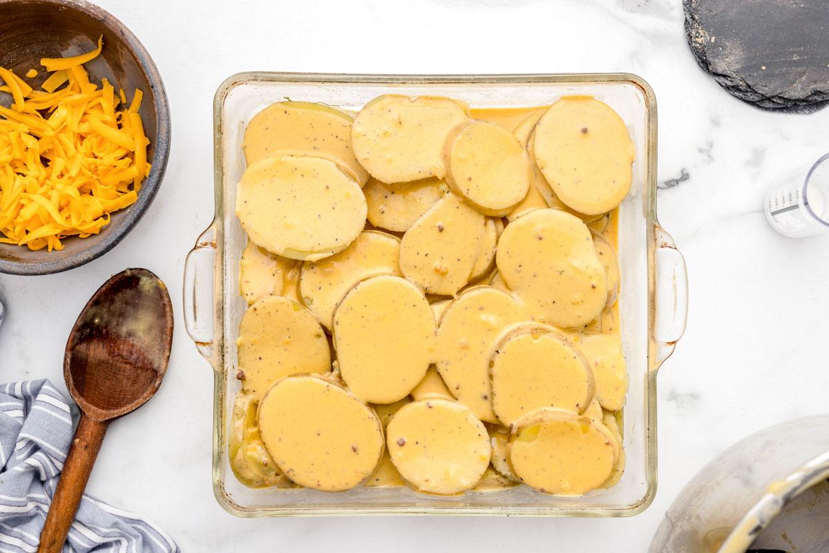 Transferring scalloped potatoes to a glass baking dish