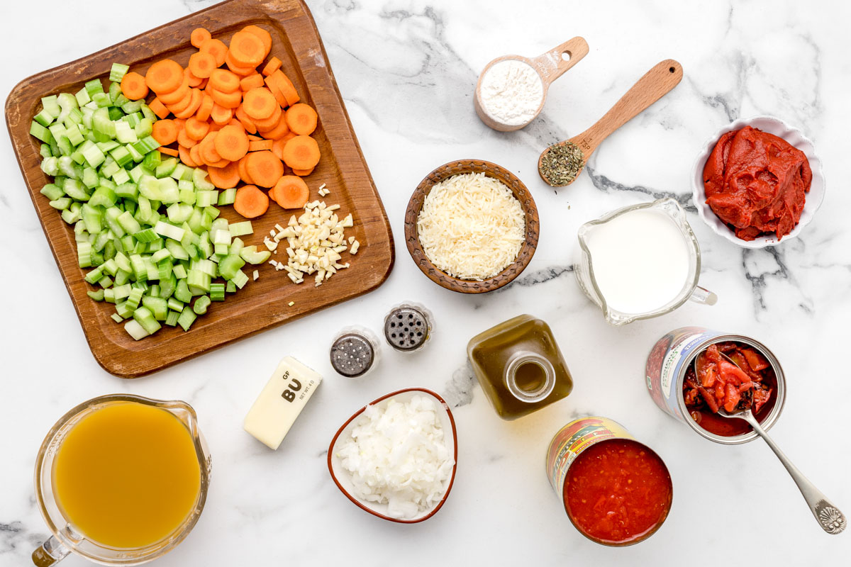 Chopped veggies and ingredients for instant pot tomato soup recipe