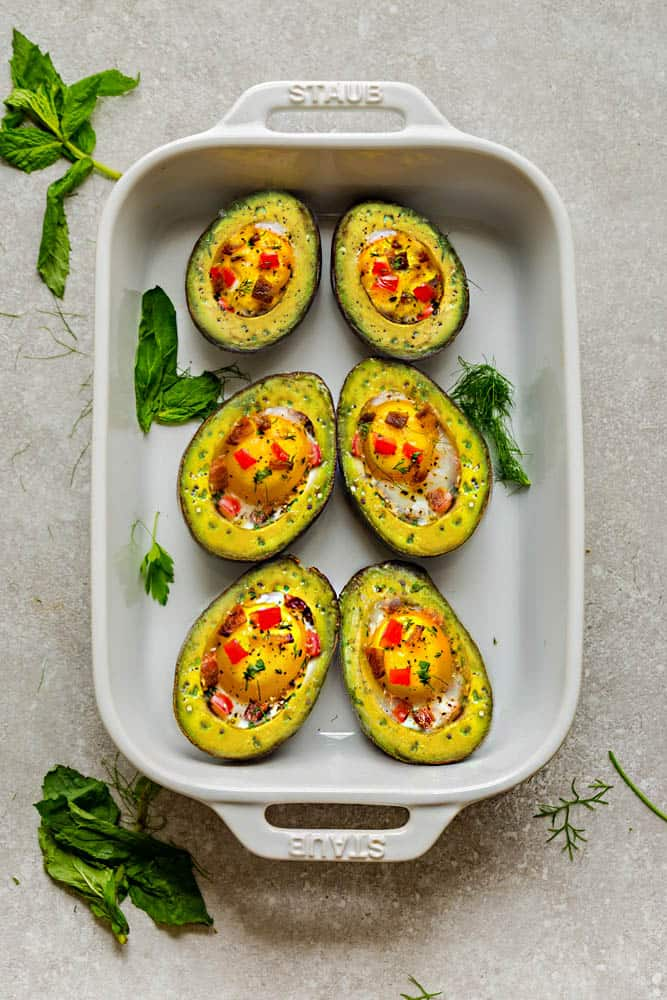 Avocado Egg Cups baked with crispy bacon and bell pepper are a super healthy and easy breakfast to start the day. Best of all, this simple recipe comes together in less than 30 minutes. Low carb, keto and paleo friendly.