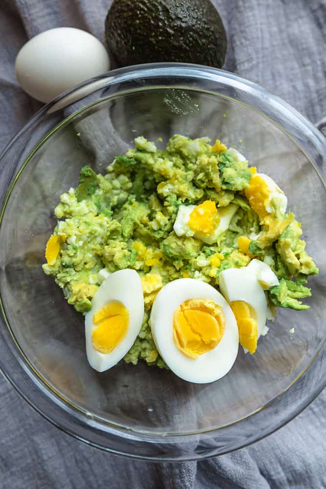 No Mayo Avocado Egg Salad is a healthier twist on the classic favorite and the perfect way to use up your hard boiled eggs. Best of all, it's super creamy and mayo free.