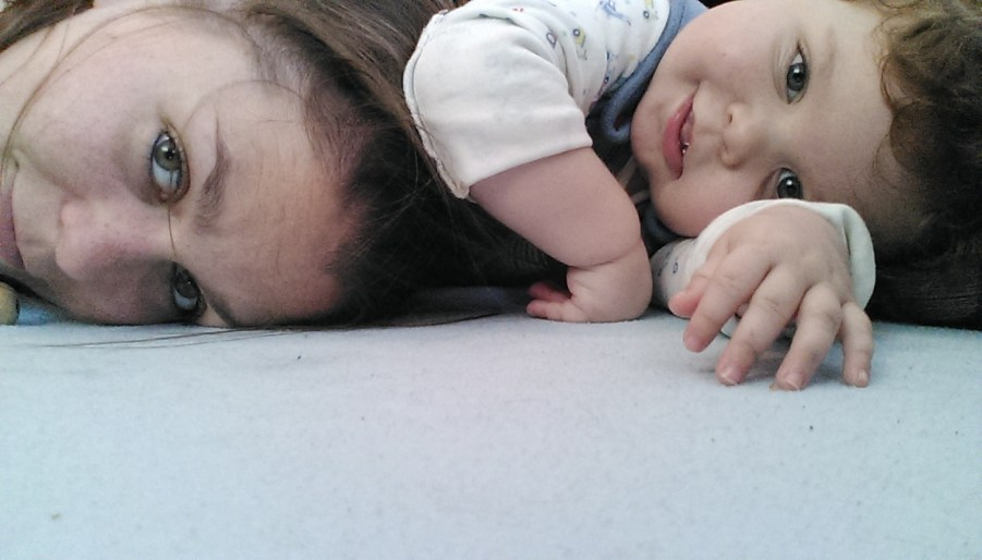 Collapsed on the floor after some rough play; you can't see, but he's holding me down by my hair!